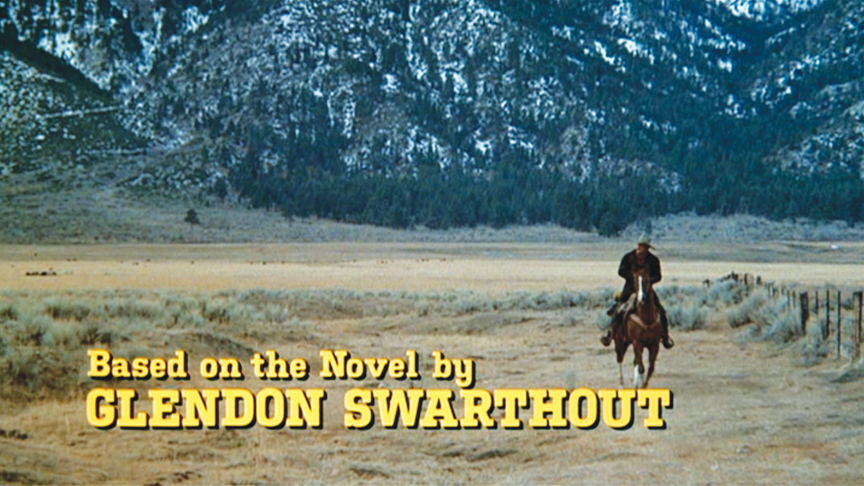 "Don Siegel's ""The Shootist"" was mostly town- and set-bound. The only nod to the visual poetry in Wayne's movies with John Ford comes with the opening titles, one long shot of Wayne riding from a great distance toward the camera."
