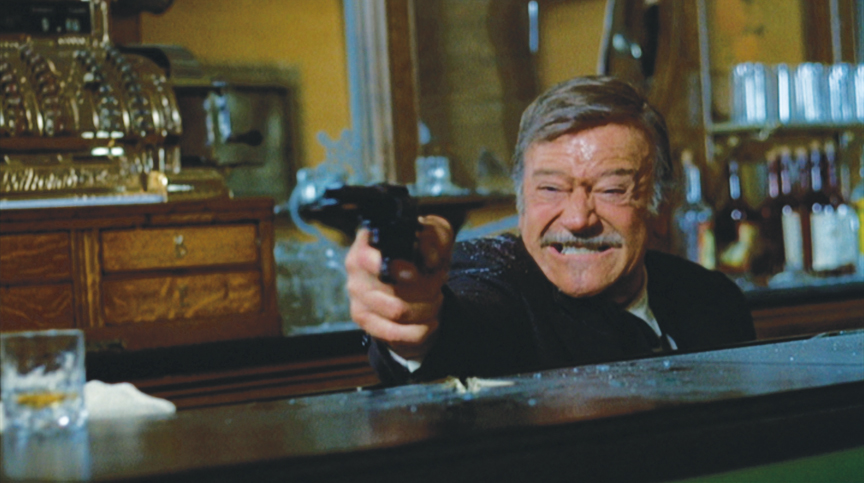 The final shootout — an old-guy fantasy. Marion Morrison died in a hospital bed, but John Wayne died in a blaze of glory.